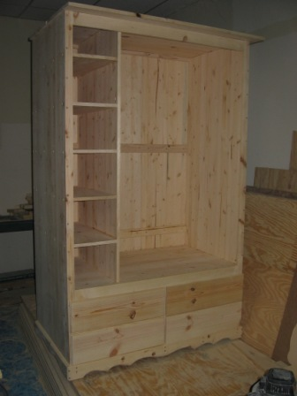 inside armoire with shelves