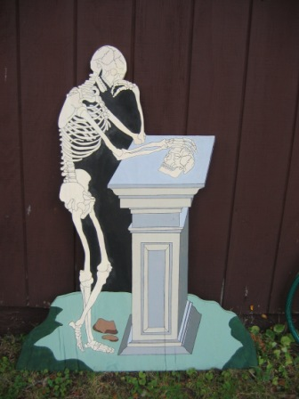 Skeleton leaning on monument